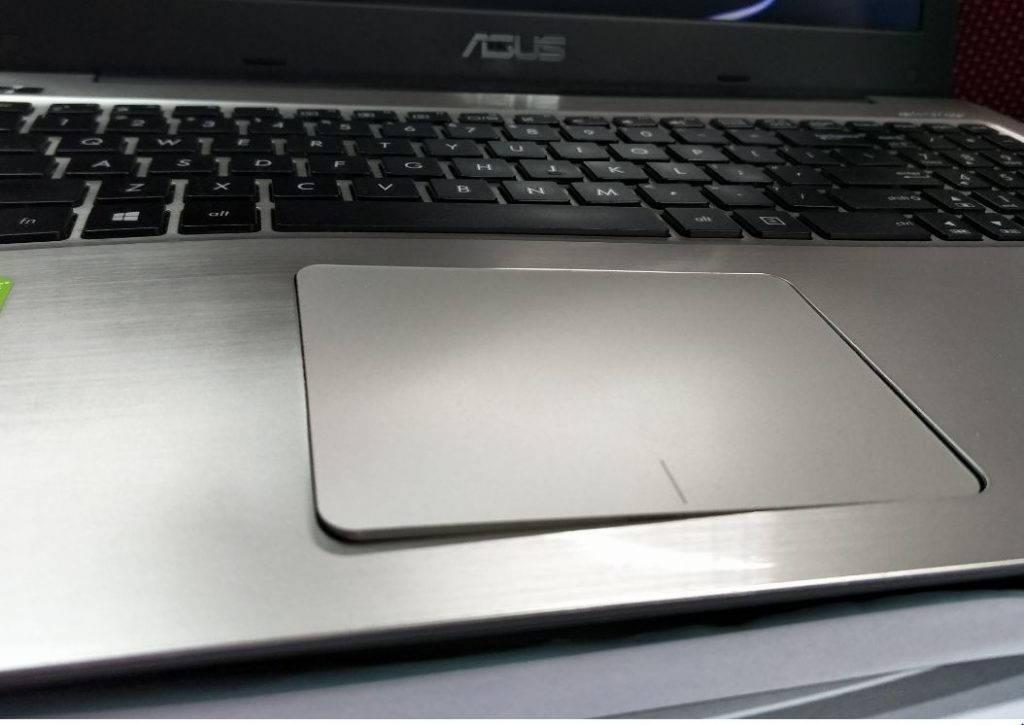 A bloated notebook battery under the touchpad