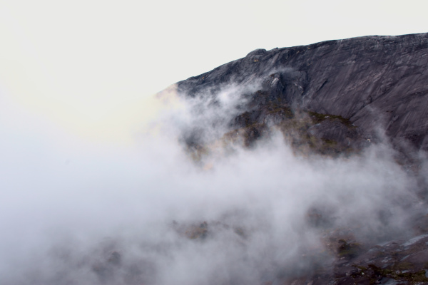 The summit of Mount Kinabalu shrouded in mist.