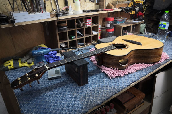 guitar lying on a table after being made