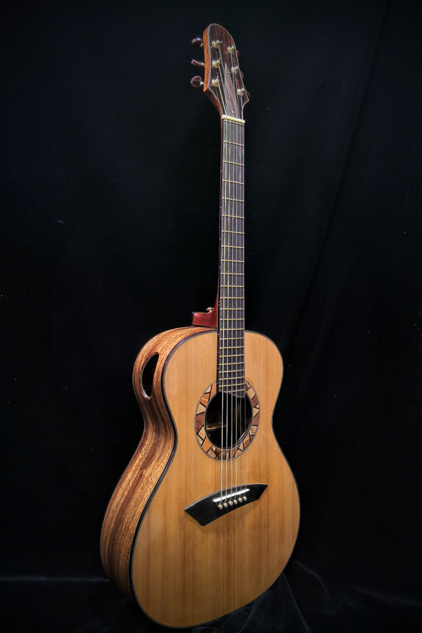 beautiful guitar standing up facing front made by a luthier