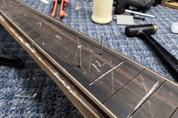 Measurements on the neck of a guitar