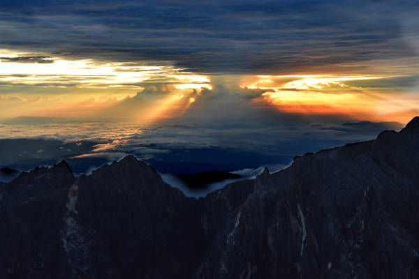 The break of dawn at Mount Kinabalu summit.