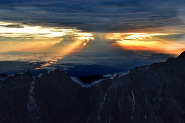 The break of dawn at Mount Kinabalu summit.