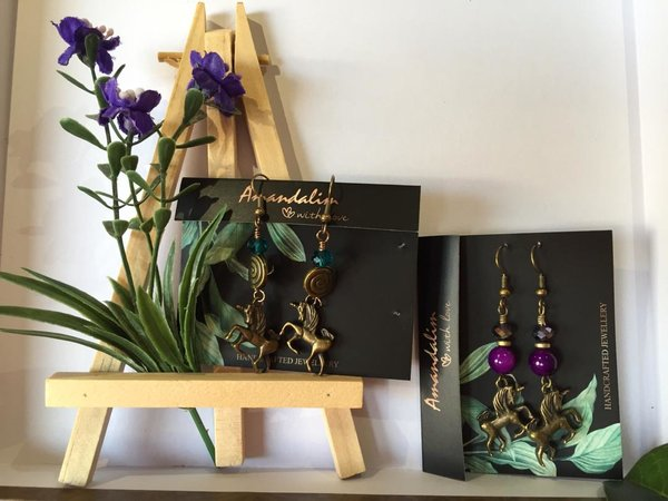 Earring sets with prancing unicorn motifs. handmade accessories