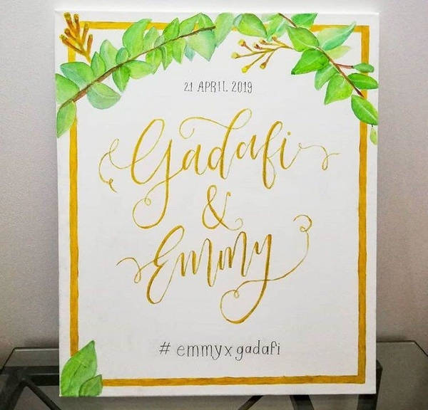 A wedding signage made from a canvas calligraphy.