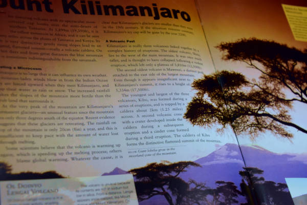 100 wonders of the world book with the page turned to Mount Kilimanjaro.