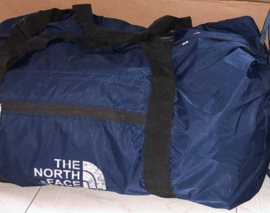 the North Face duffel bag.