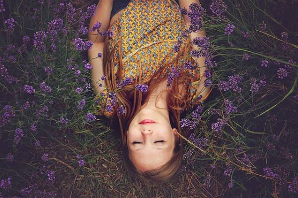 Girl relaxing in a field of lavender
