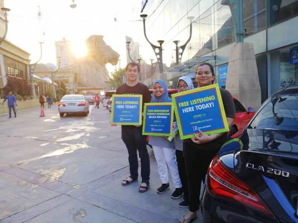 The Sidewalk Talk volunteers promoting their free listening project.