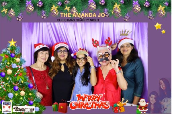Christmas-theme photo booth at Aunt Amanda's party