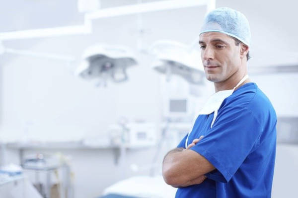 Your choice of dentist in blue scrubs.