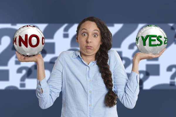 The choice between yes and no by a lady holding two option balls.