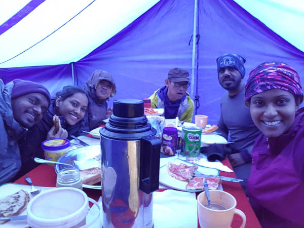 The dream team sharing a light banter over dinner at Machame Camp before calling it a night.