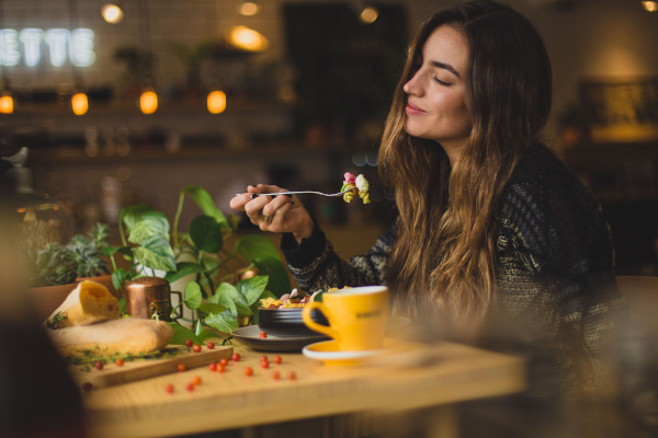 Millennial woman enjoying the experience of eating
