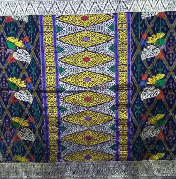 A patterned songket with a floral motif.