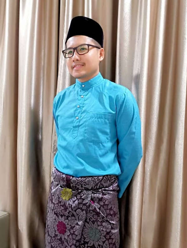 The Man With The Bronze Songket.