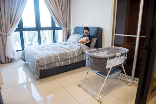childbirth, fully furnished bedroom with queen sized bed, curtains bassinet for baby and more.