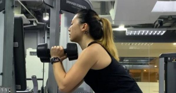 Vicky Lee at the gym, working out