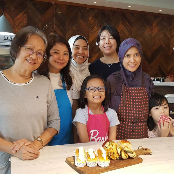 Happy faces after making soft rolls and cream filled buns at the Master Baker cooking class