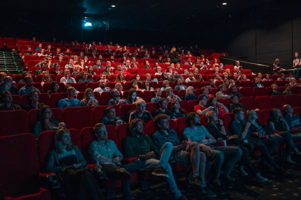 People sitting in a cinema watching a movie.
