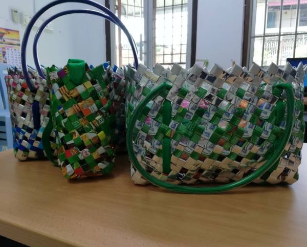 Handcrafted bags made by Breast Cancer Support Society Segamat. Recycled materials are used in making the bags.