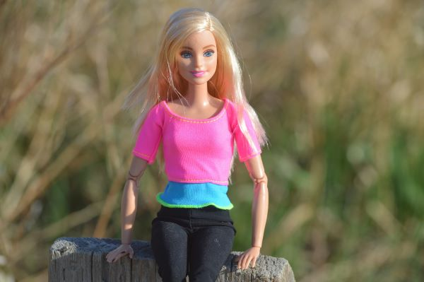 The colour Pink symbolises Barbie as it is her fashion style.