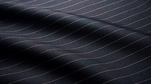Dark blue merino wool with purple pencil stripes, a wise option to stay elegant and cool in a warm climate.