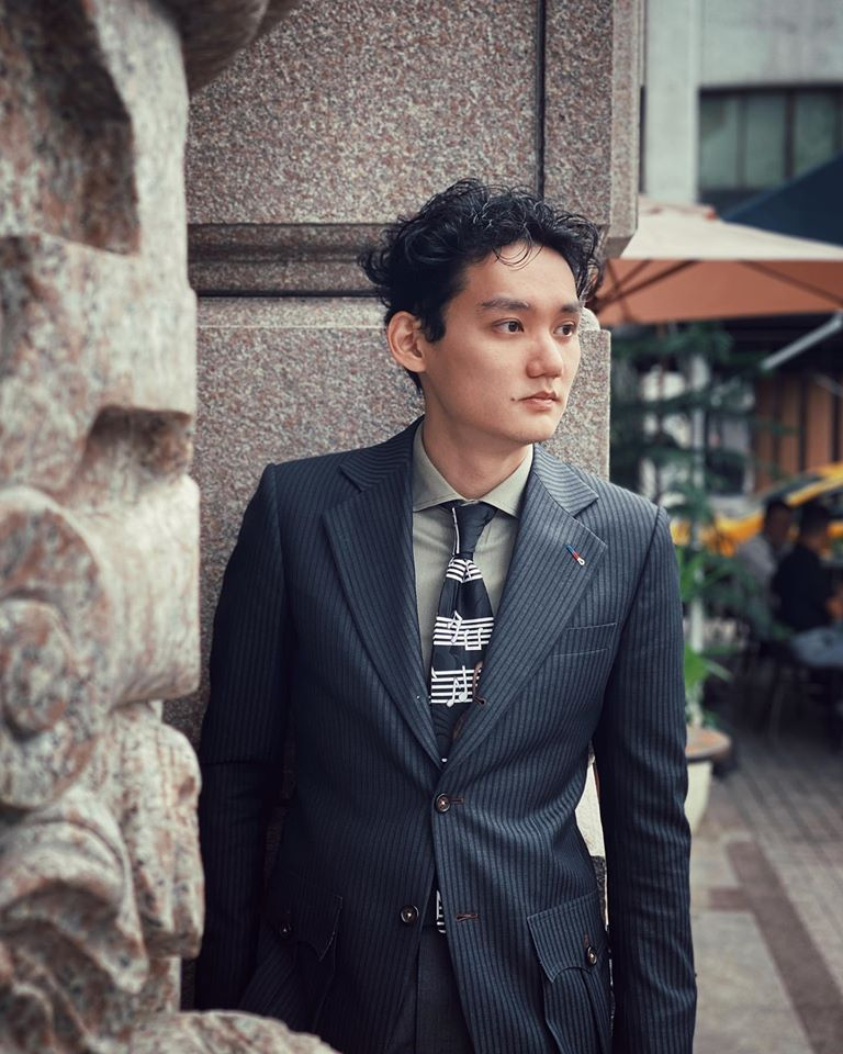 Sky Ng wearing a Gent's Prop custom-tailored Italian style suit. Paired with a widespread collared shirt and printed silk tie.