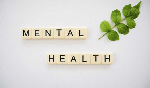 """""""MENTAL HEALTH"""" spelt out in Scrabble pieces."""