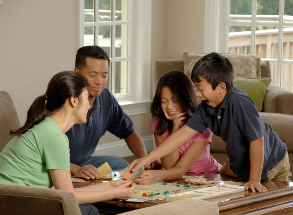 A family of four enjoying the afternoon with board games.