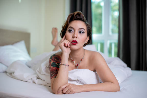 Boudoir uses facial expressions to convey a message rather than body language in fashion modelling.