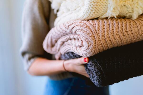 A woman holding blankets