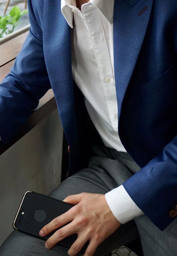 Blue glen check blazer with grey pants for the smart-casual setting.