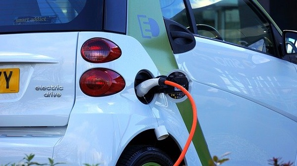 Electric car being plugged in