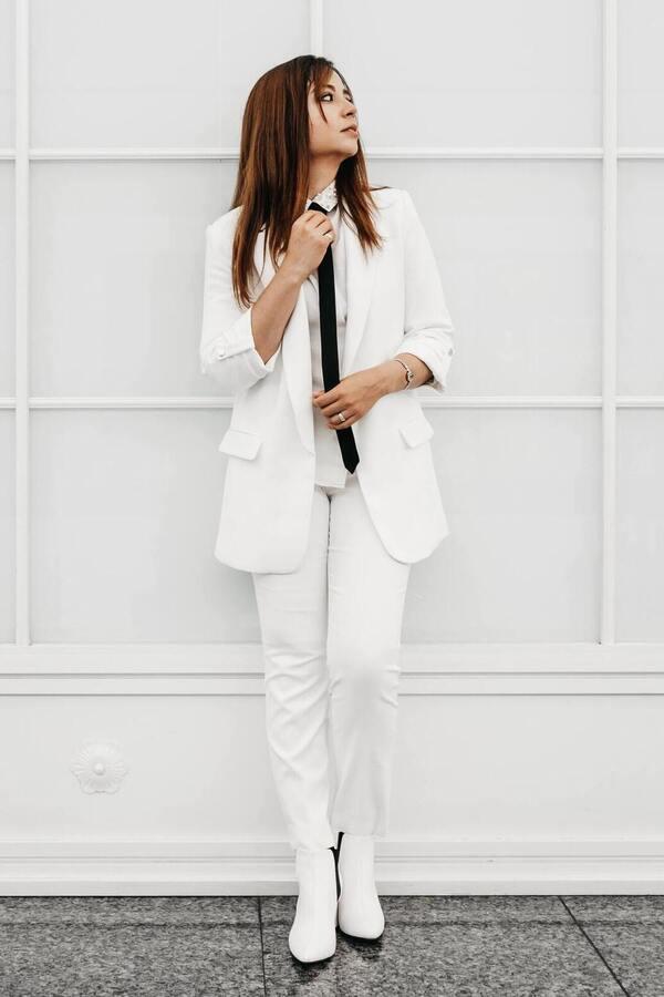 woman black tie two-piece suit  shirt  white suit
