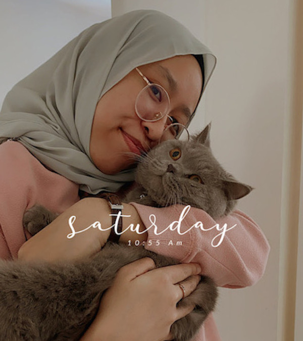 Atiqah holding her cat, Abu after a few months he came into the family.