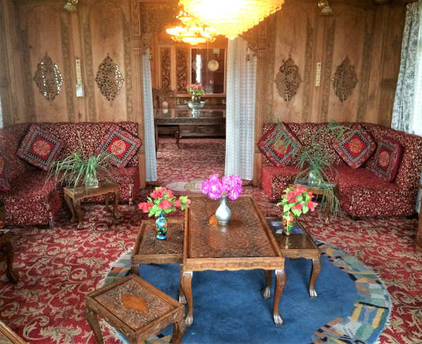 The elaborate interior of one of the houseboats on Dal Lake.