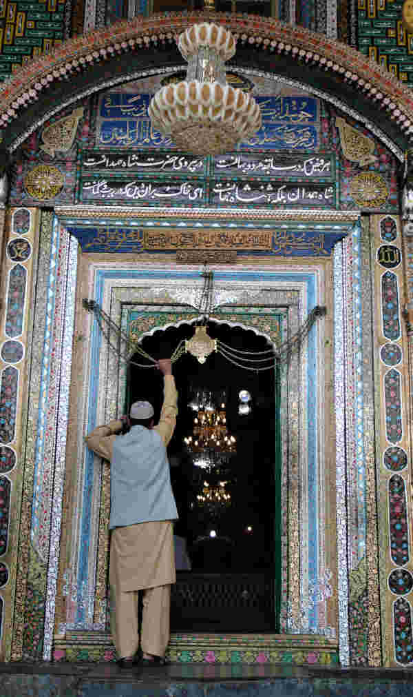 A devotee at the doorway of  Khanqah Shah-I-Hamdan, Kashmir.