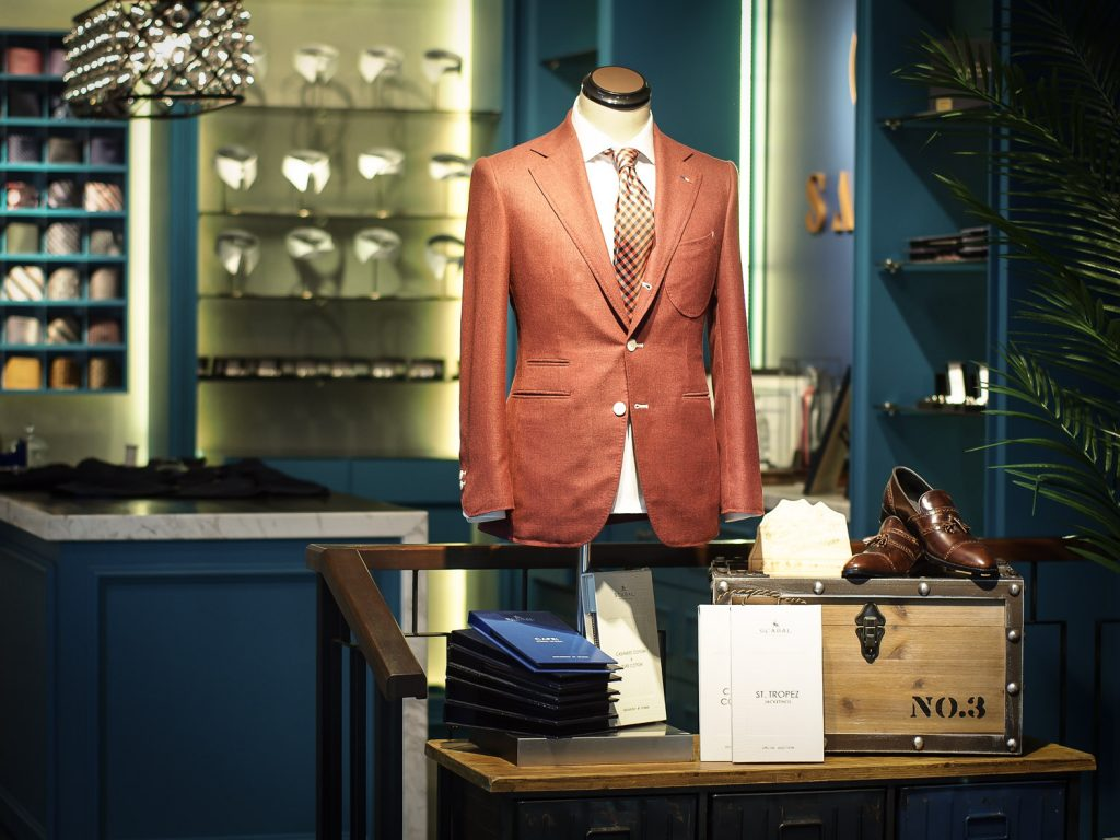 A brown bespoke suit on mannequin