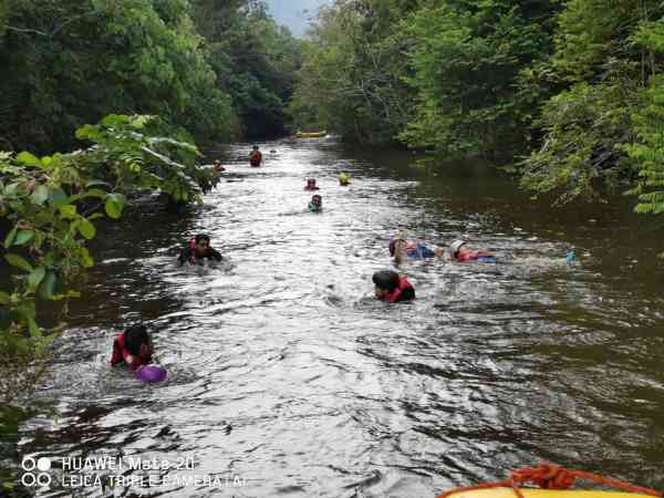 Participants floating on the calm river before the end point