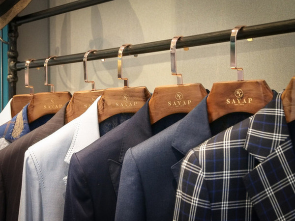 Suits hanging in row