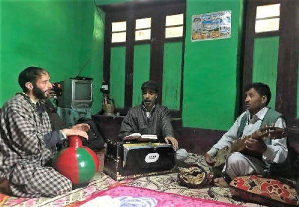 Three Sufi musicians with the traditional instruments - Kashmiri nott, harmonium and rubab.