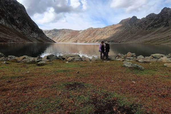 At the edge of Tarsar Lake, the changing season evident in the tones of nature.
