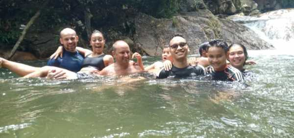 Taking a dip with the group at Chillings Waterfalls