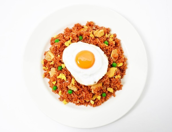 A plate of nasi goreng garnished with an egg