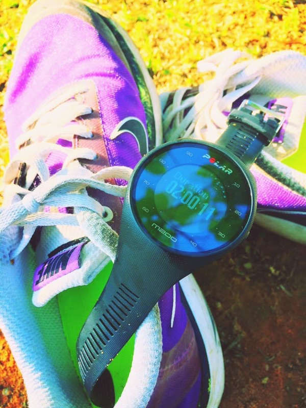 A worn out pair of Nikes with the basic Polar fitness watch that tracks your location, distance, heart-rate and pace.