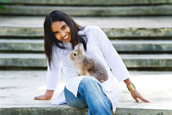 Ms Jay pictured with a rabbit.