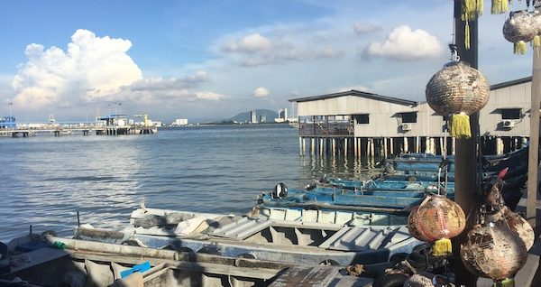A photo of Chew Jetty with sampan boats docking at the edge.