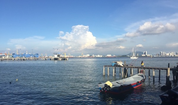 A photo of the view at the end of Chew Jetty, where you can see this view of the horizon and ships sailing.