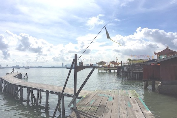 A photo of the boardwalk at Yeoh Jetty where you can see the end of the plank as well as this vast view of the sea.